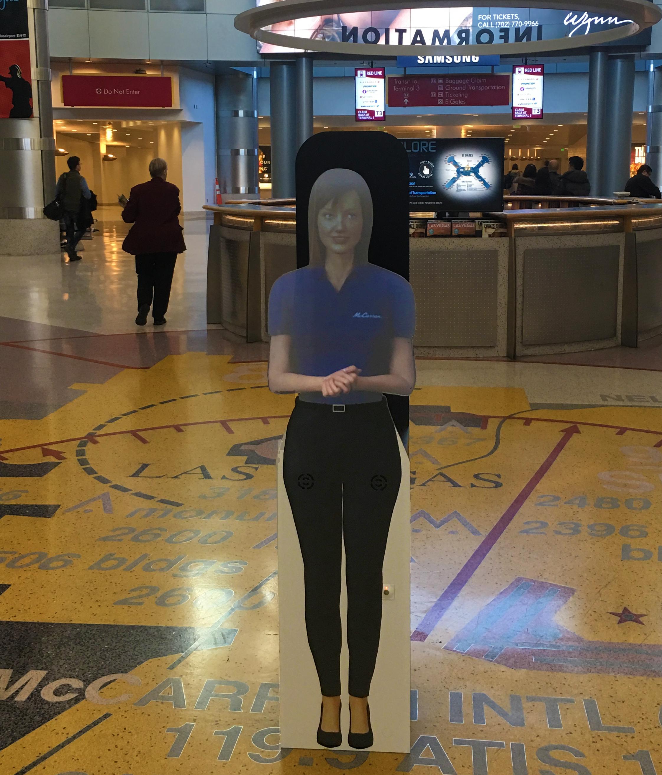 female prsonas hologram standing in mccarran airport