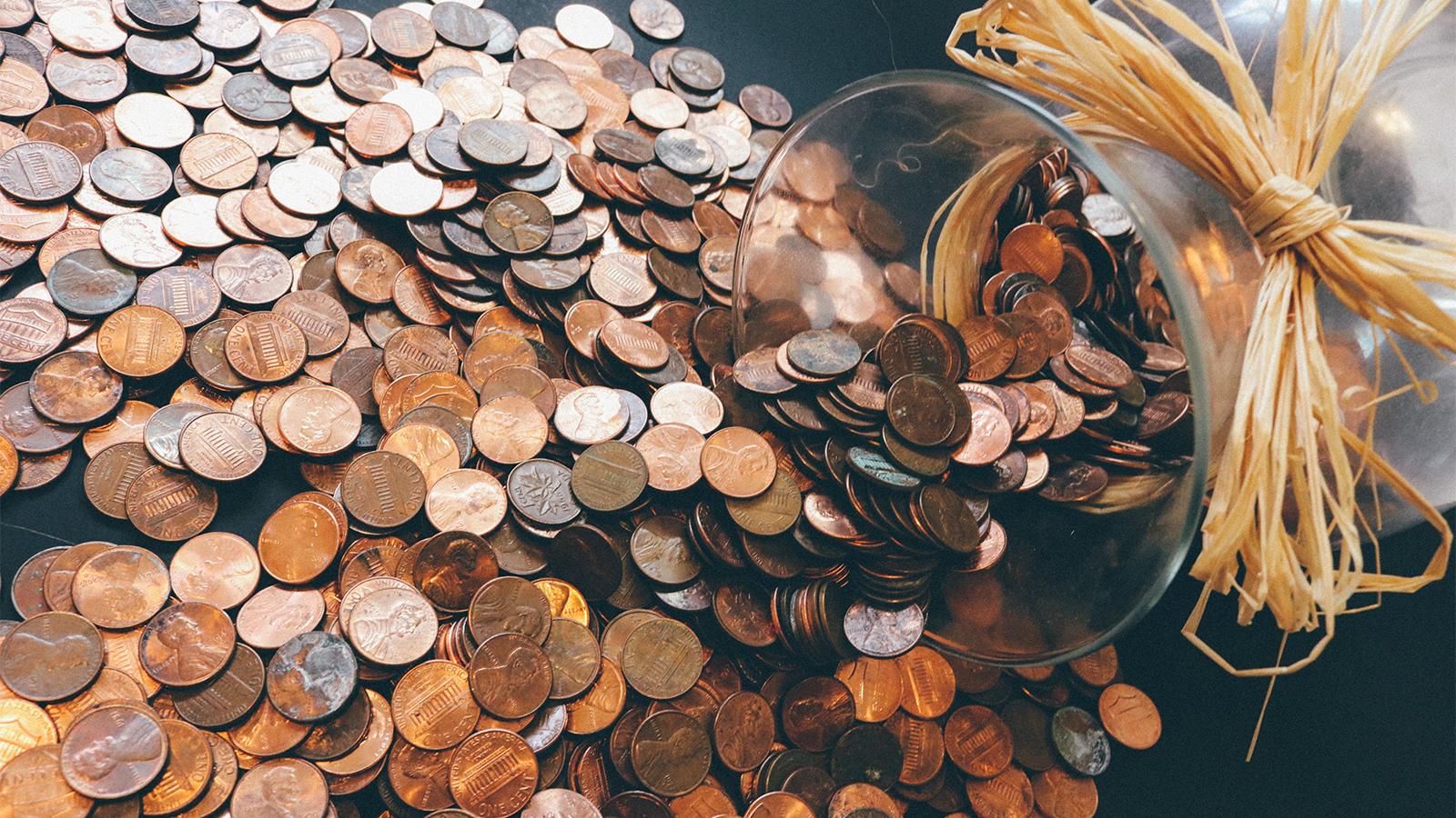 jar tips over spilling pennis